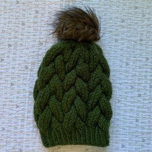 Dark green knit hat with faux fur Pom